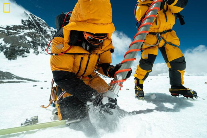 A photo of scientists drilling an ice core on Mount Everest