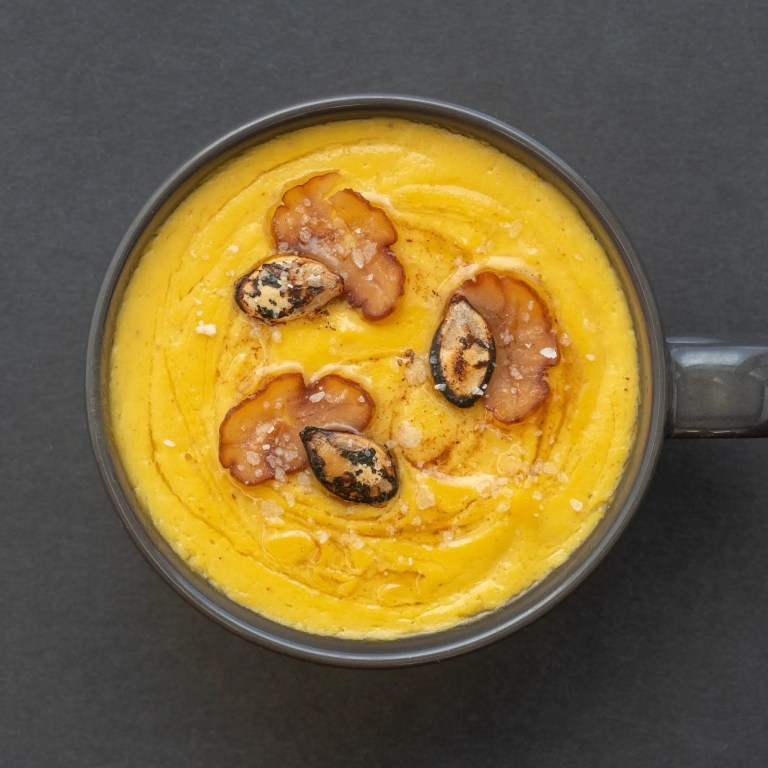 Umami Butternut Squash Soup with brown butter sage, roasted squash seeds, and sliced roasted chestnuts.