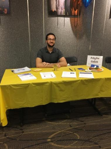 Manning the employee wellness booth at a health and benefits fair