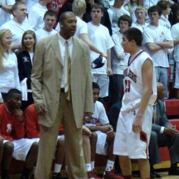 Lewis coaching his team from the sideline. photo credit: varsitysportsnetwork.com
