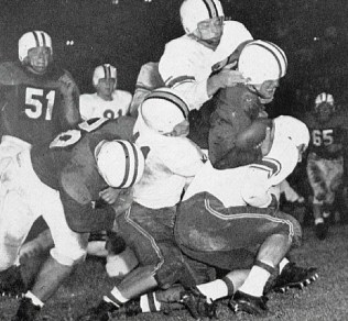 A Maryland defender delivers a bruising tackle.