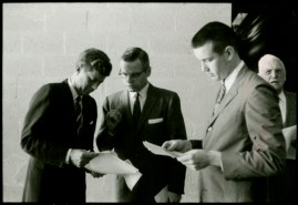 JFK reviewing notes prior to his speech on campus in 1959.