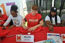 Freshman Kevin Huerter of the men's basketball team signs autographs for fans.