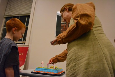 Mithril Turtle founder Michelle Butler lights candles to celebrate the 111st birthday of LOTR character Bilbo Baggins. (Jin Kim/Co-Managing Editor)