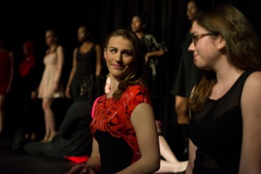 """Erin Klatt (left), one of the co-coordinators for """"The Vagina Monologues"""" at UMD, sits with Carly Moore (right) on stage for the skit """"The Woman who Loved to Make Vaginas Happy."""" (Ryan Eskalis/Bloc Reporter)"""