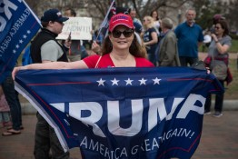 "Lisa Moulden, Trump supporter and Author of a book titled, ""Presidential Souls,"" excitedly holds a Trump sign in front of the White House as a sign of support for the President on Saturday, March 25, 2017. Lisa, along with other demonstrators, travelled from around the country for the ""Make America Great Again March"" in Washington, D.C. (Josh Loock/Bloc Photographer)"