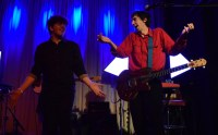 Eric Slick retakes the stage with Steve Marion for a laugh during the middle of Delicate Steve's set Friday, March 10, 2017. (Jordan Stovka/Bloc Reporter)