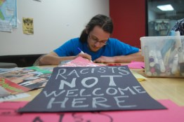 """Pete Myers, a senior economics major and coordinator of the poster party, wanted to host an event to publicly oppose the white supremacist posters found on campus. """"Something needs to be done. I didn't see a response before and I know there needs to be one. Feeling like a community and linking people together is really cool."""" (Naomi Harris/Bloc Reporter)"""