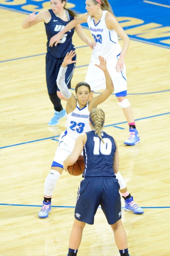 Jasmine McRoy defends Aliza Simpson of UNH at the Tsongas Center. (Photo courtesy of Brian Fluharty.)