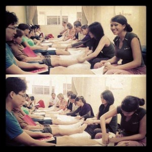 A group of people giving Thai foot massage