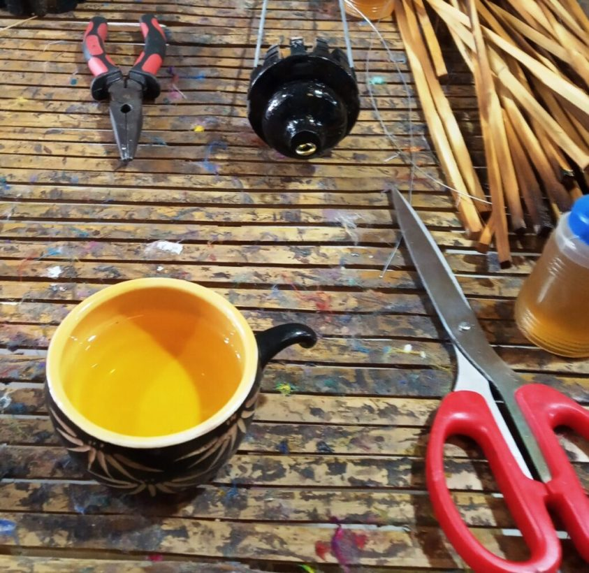 A cup of tea with lantern making equipment