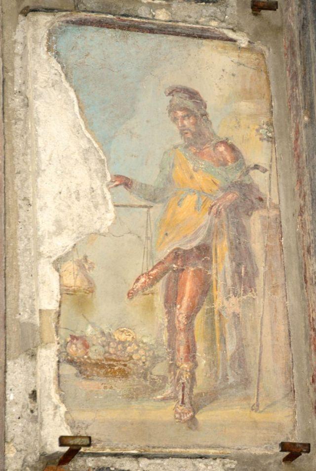 Afresco de Pompéia p Príapo o Deus da Fertilidade, medindo o seu falo.