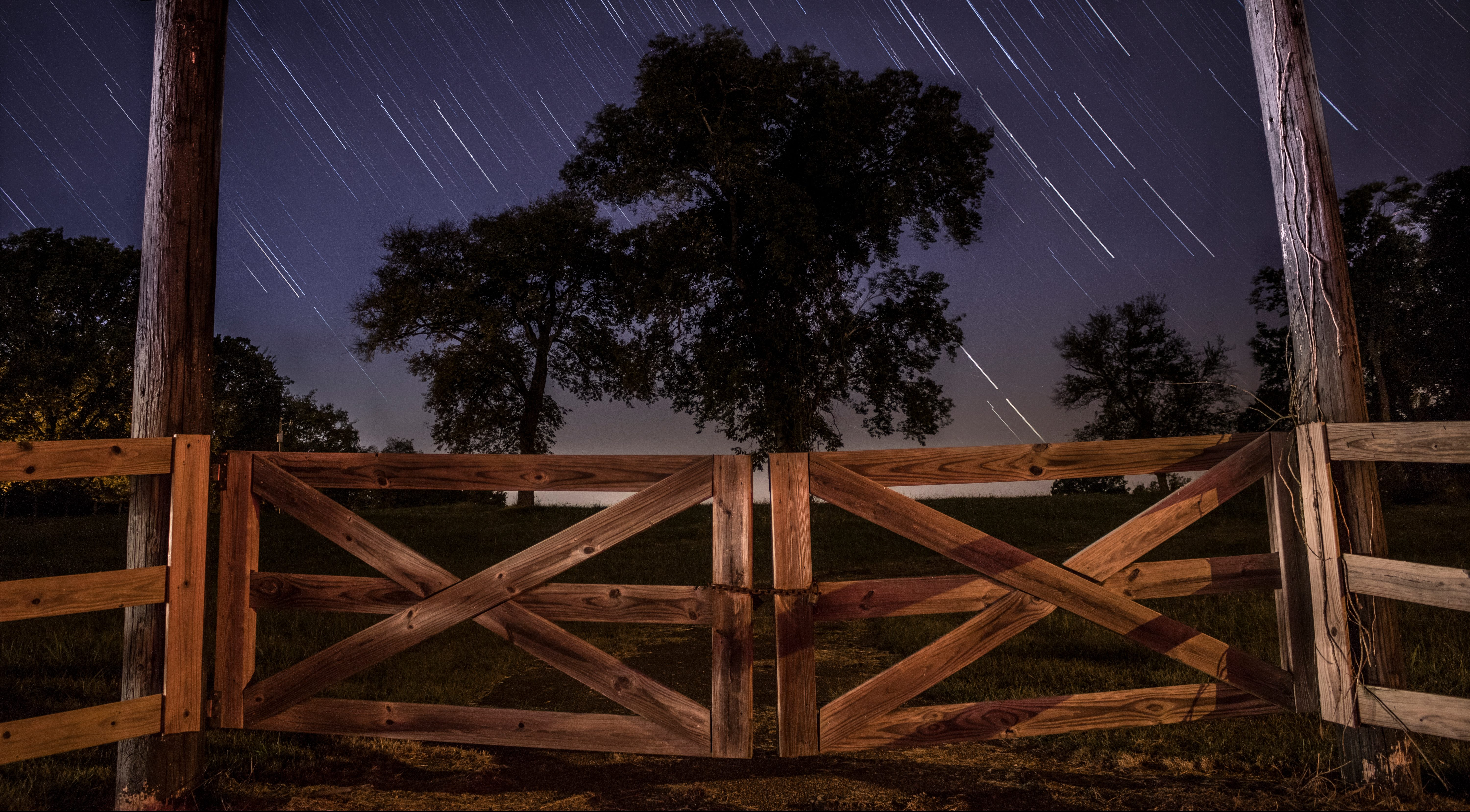 A photo of a gate on a starry night by John Moore Lebanon, United States, Unsplash