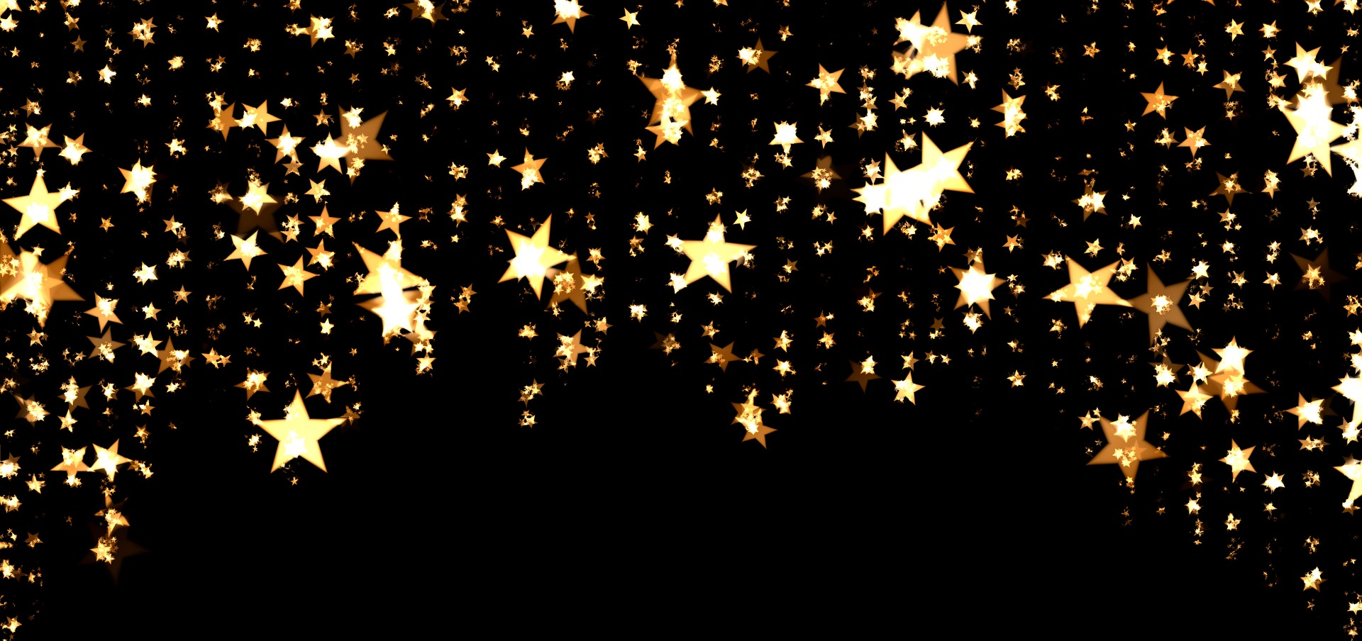 A photo of gold stars against black by geralt on Pixabay