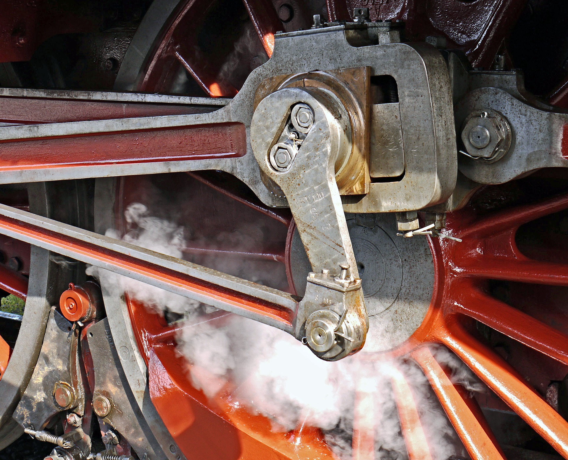 A picture of a steam locomotive wheel by hpgruesen from Pixabay