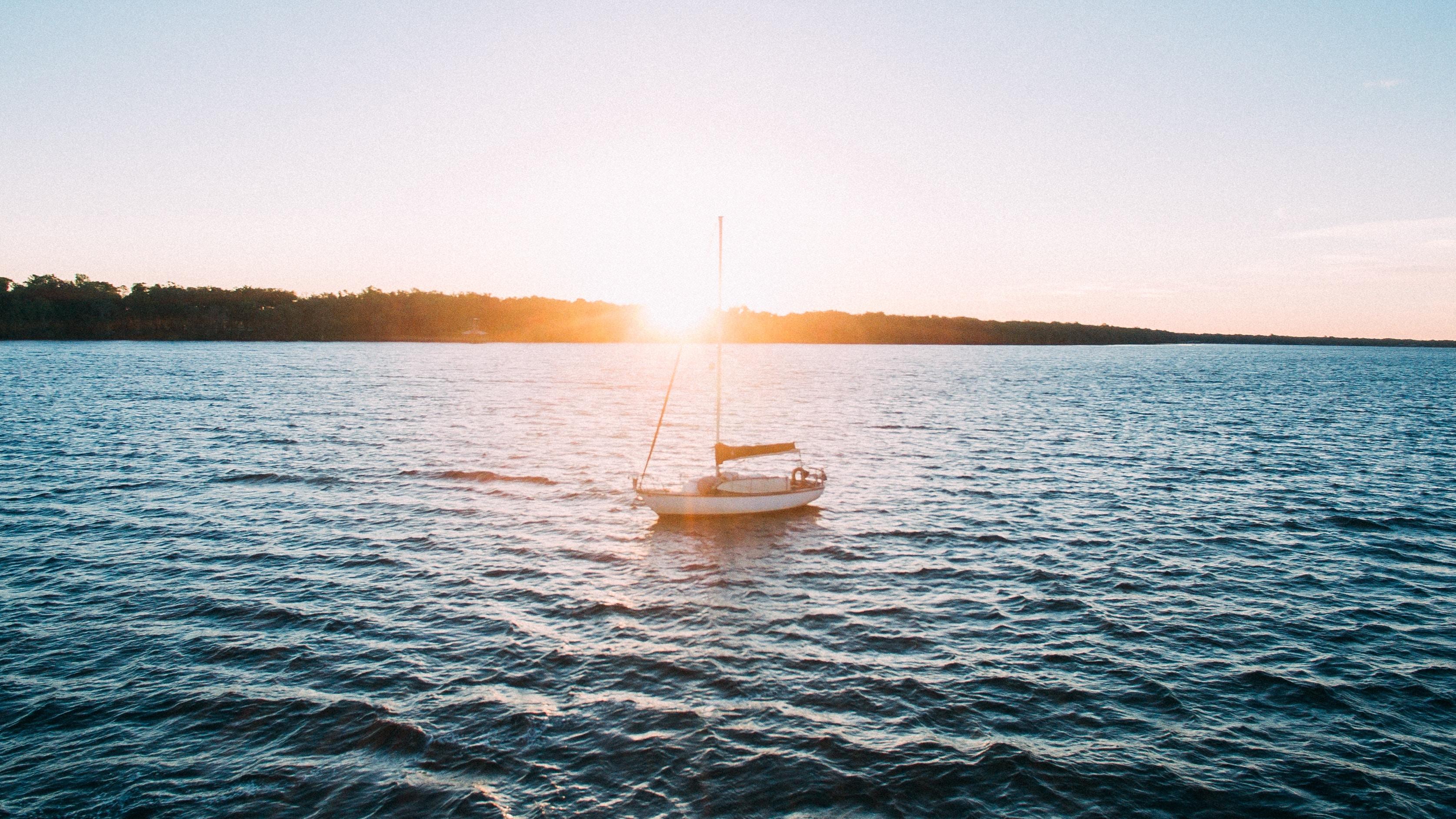 A photo of a small sailboat by Lance Asper on Unsplash