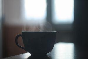 Photo of a steaming coffee mug by John-Mark Kuznietsov on Unsplash