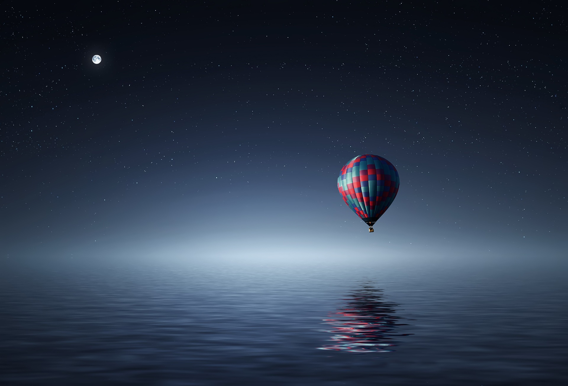 A digital illustration of a hot air balloon floating over water at night from Pixabay