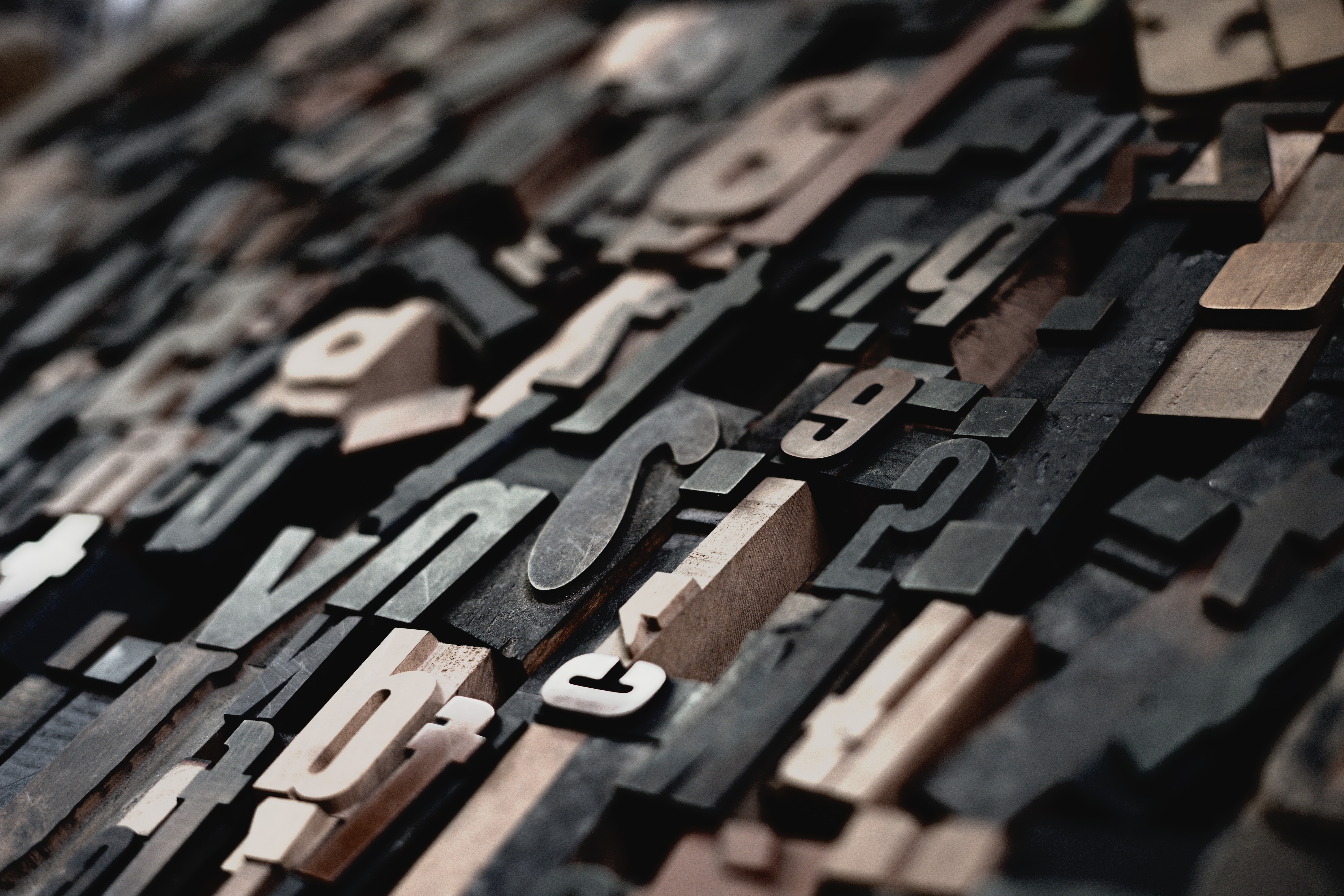 A photo of wooden letters by Raphael Schaller on Unsplash