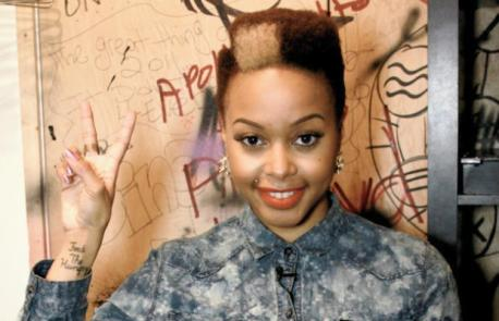 Chrisette Michele plays with color and shape with a more boxy version of her signature look. Photo via Singersroom.com.