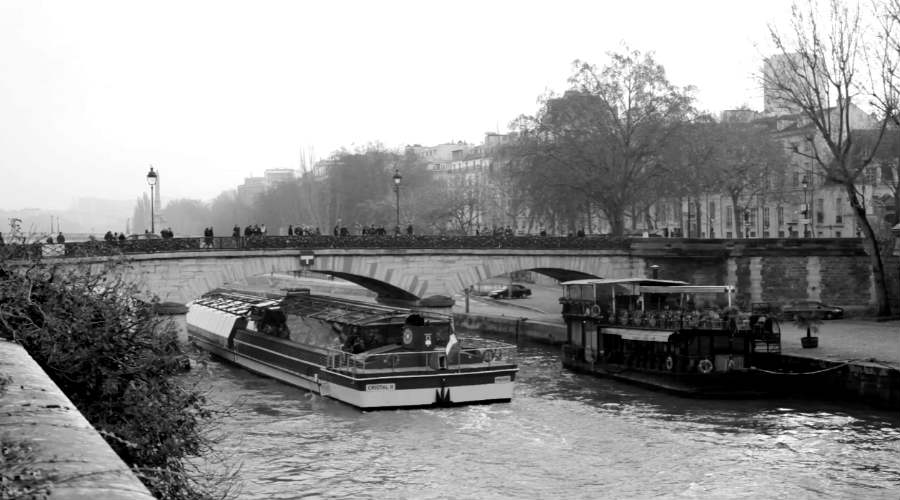 """The Seine divides Paris into two parts–the left and right bank, with the left bank being more like New York's Upper East side and the right bank being a little more 'funky.' In the summer the City turns part of the Seine into """"Paris Plage,"""" a beach within the city. Locals tend to steer clear of the 'plage' but it can actually be a pleasurable experience"""