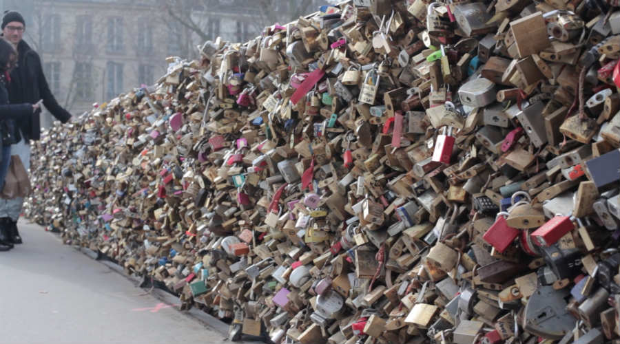 Pont de l'Archevêché is one of the many bridges on which lovers from all over the world leave their locks of love. But several of these beautiful bridges in Paris are actually being weighed down by those loving mementos and the city has begun cutting many of the locks off.