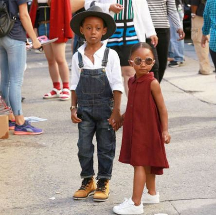 Child street style stars personify retro cool in denim suspenders and a button down dress.