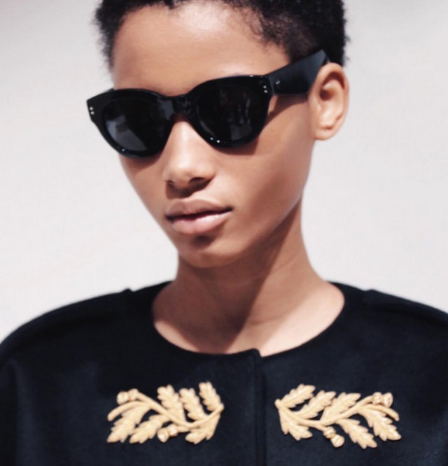 Dominican beauty Lineisy pairs her TWA with dark glasses at Burberry's Kensington Gardens show.
