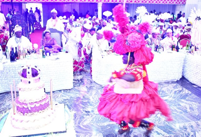 A cross-section of guests at the reception, admiring the rich cultural display of the Efik traditional dancer.