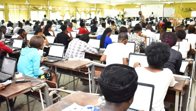 A cross-section of students writing their examinations