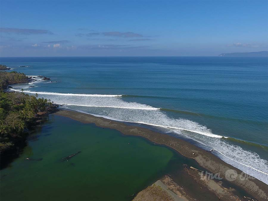 Surfing waves in Pavones, Costa Rica from drone