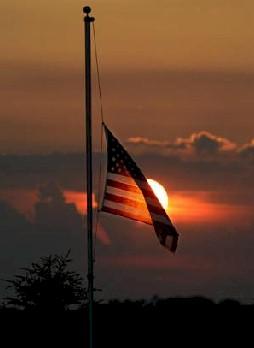 us-flag-capitol-half-staff.jpg