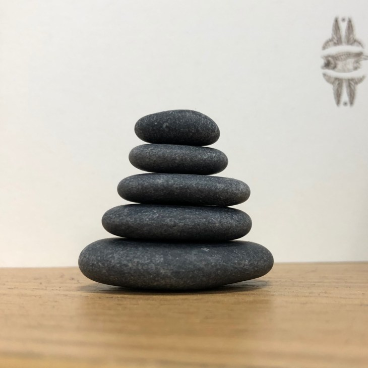 stack of 5 smooth, flat, gray stones