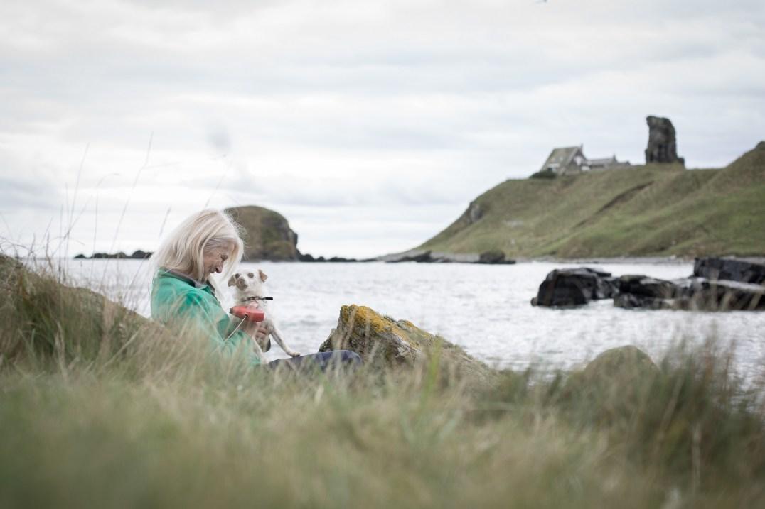 Rebecca and rescue dog in her Scottish homeland.