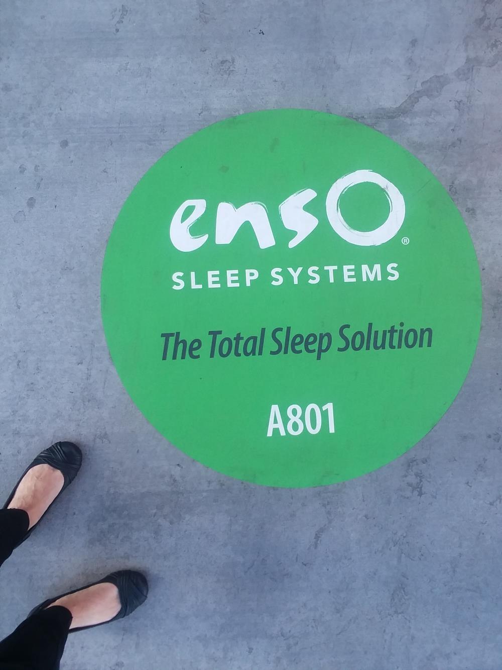 mattress ads on sidewalk
