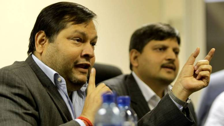 Indian businessmen Ajay and Atul Gupta