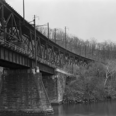 The upper span of this bridge is the 1560 foot long Safe Harbor Trestle located at the Safe Harbor Dam, PA. It is a steel deck truss trestle that spans the Conestoga River at Safe Harbor. Below it is the Port Road Bridge.