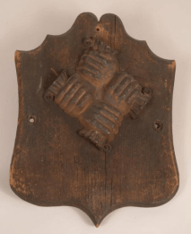 Early fire mark made of wood. Eventually, they were cast in lead.
