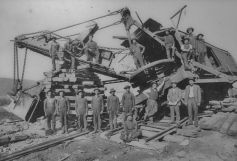 Workers pause for a photo with a steam shovel on the job site. Kline Collection, Railroad Museum of Pennsylvania, PHMC
