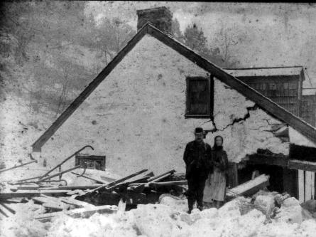 A couple pose on top of ice on the second floor of their home in Safe Harbor.