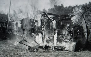 A trolley car on fire at Rocky Springs.