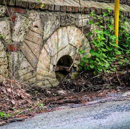 Embedded millstone along Route 324 built by Paul Flory.
