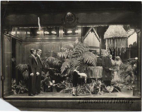 "Window display at Watt and Shand entitled ""The Wedding""- showing tuxedos and formal wear."