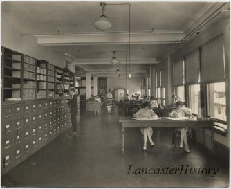 People at work at the offices of Watt and Shand's department store.