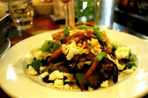 The fare is creative if erratic at Skek, where you may find this salad of roasted veggies with goat cheese on the menu.