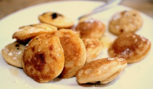 Poffertjes are fluffy pancakes served with melted butter + powdered sugar.