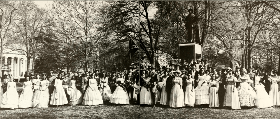 Kappa Alpha Fraternity, Yackety Yack Yearbook, 1969, 312-313. // Dressed up for the Old South Ball, members of the Kappa Alpha Fraternity stand with their dates in front of the University's Confederate Monument, utilizing the monument a space in which to uphold institutional white supremacy.