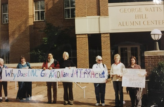 """Why Does UNC Give An Award Named After A Racist?"" Sign at Protest of the Cornelia Phillips Spencer Bell Award, 2002 in the John Kenyon Chapman Papers #5441, Southern Historical Collection, Wilson Library, The University of North Carolina at Chapel Hill."