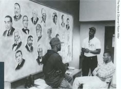 Black Awareness Council meet in the Black Cultural Center, Carolina Alumni Review, Winter 1992, Page 16.