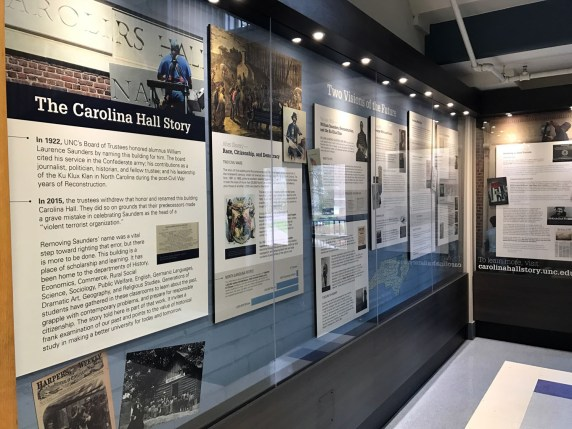 """Carolina Hall Exhibit, Curated by members of the Chancellor's Task Force on UNC-Chapel Hill History. Photograph in Brooks, Maya, """"Artifact of the Month: Saunders Hall plaque,"""" North Carolina Miscellany Blog, 24 February 2017."""